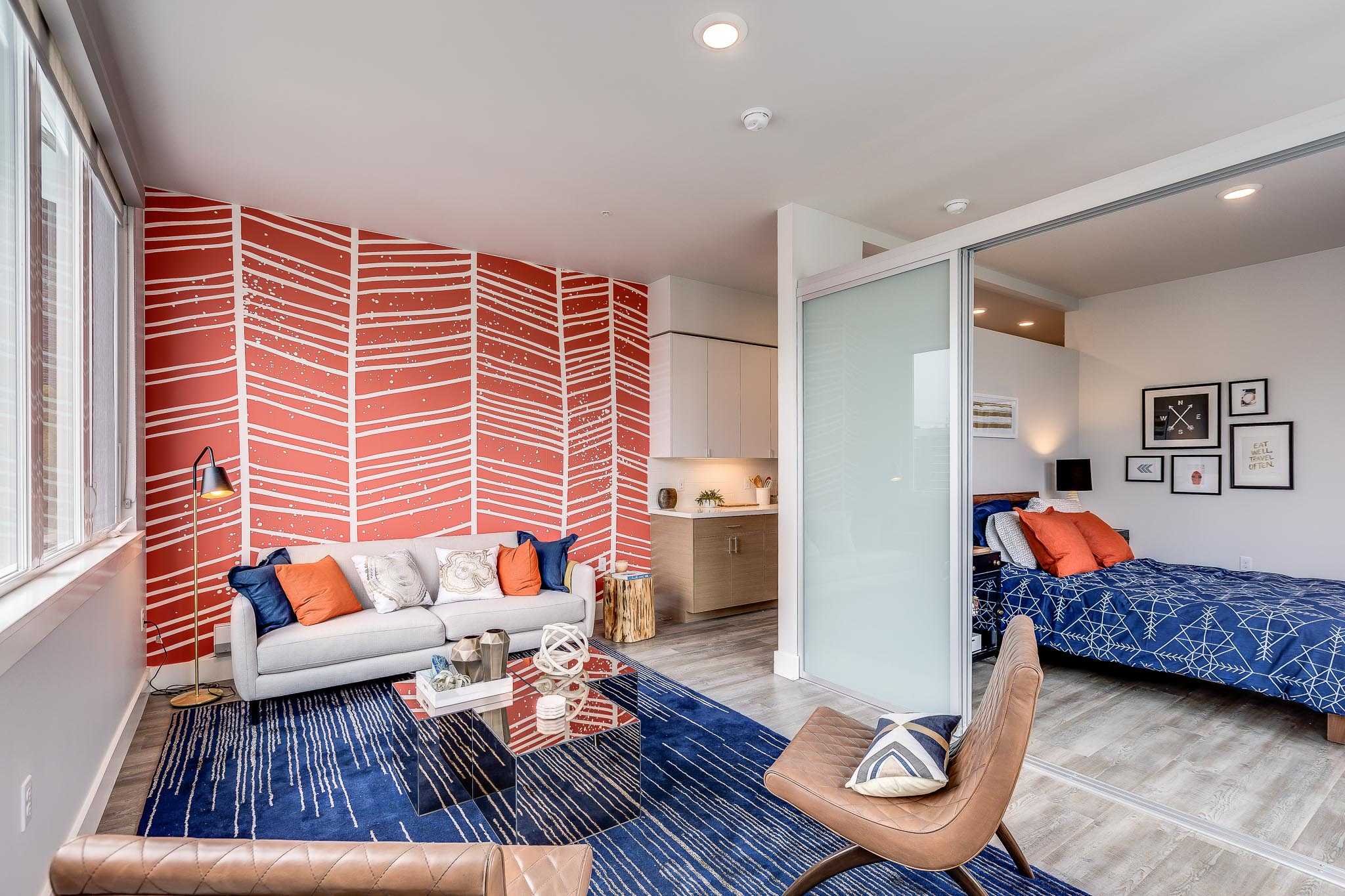 Modern Studio Apartment with blue and orange accent colors